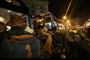 Migrants leave Budapest train station to board buses for Austria September 4, 2015. Thousands of migrants crossed into Austria, after Hungary's surprise move to take them by bus to the border.