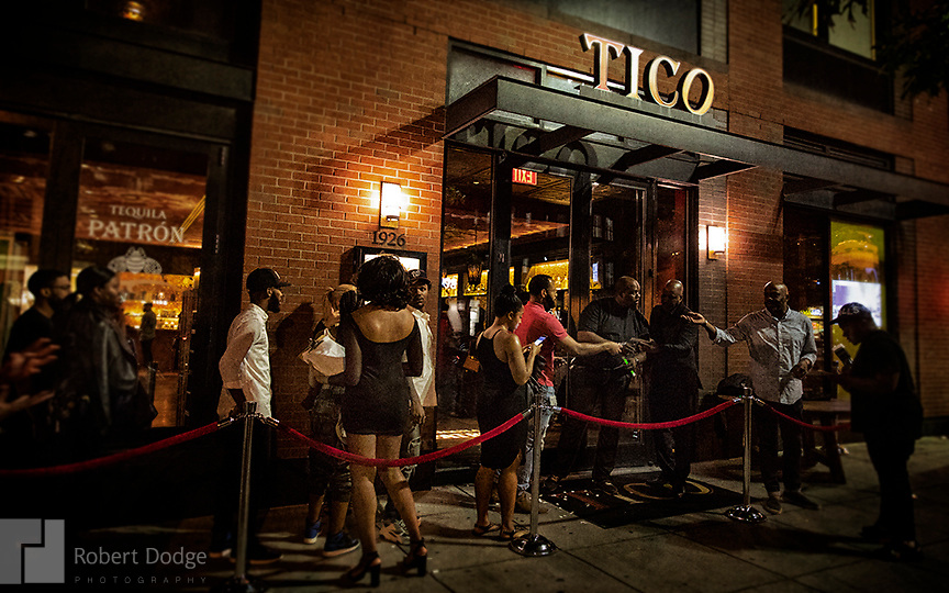 """You gotta be cool to get in this tequila event at Tico on 14th Street. A dapper dandy makes his way up the street from grocery shopping -- perhaps eager to taste the goodies he just purchased. This image is from Robert Dodge """"Project: 14th and U Streets,"""" a look at the center of town in Washington, D.C. For info on publication or fine-art-, limited-edition prints, contact: Robert@RobertDodge.com."""