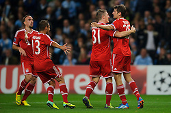Bayern Defender Philipp Lahm (GER) celebrates with Bastian Schweinsteiger (GER) and Franck Ribery (FRA) after scoring a goal during the second half of the match - Photo mandatory by-line: Rogan Thomson/JMP - Tel: Mobile: 07966 386802 - 02/10/2013 - SPORT - FOOTBALL - Etihad Stadium, Manchester - Manchester City v Bayern Munich - UEFA Champions League Group D.