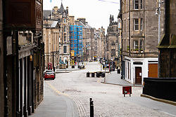 Edinburgh, Scotland, UK. 24 March, 2020.  Deserted streets in the heart of the Old Town tourist district in Edinburgh. All shops and restaurants are closed with very few people venturing outside following the Government imposed lockdown today. Pictured; View along the normally busy High Street and Royal Mile. Iain Masterton/Alamy Live News