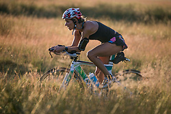 © Licensed to London News Pictures. 25/06/2020. London, UK. A woman cycling in warm weather in the early morning at Richmond Park in west London. Record temperatures are expected this week as the UK starts to relax lockdown restrictions, introduced earlier this year to prevent the spread of COVID-19.<br /> Photo credit: Marcin Nowak/LNP