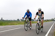 UK, Chelmsford, 28 June 2009: Two cyclist who were not competing in the Chelmer Cycle Club's Open Time Trial Event on the E9 / 25 course. Photo by Peter Horrell / http://peterhorrell.com .