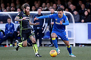 AFC Wimbledon attacker Harry Forrester (11) taking on Bristol Rovers midfielder Stuart Sinclair (24)  during the EFL Sky Bet League 1 match between AFC Wimbledon and Bristol Rovers at the Cherry Red Records Stadium, Kingston, England on 17 February 2018. Picture by Matthew Redman.