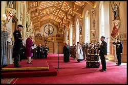 April 25, 2018 - London, London, United Kingdom - Royal Tank Regiment new standard. Queen Elizabeth II, who is Colonel-in-Chief of the Royal Tank Regiment, presents them with a new standard in St George's Hall at Windsor Castle in Berkshire. (Credit Image: © i-Images via ZUMA Press)