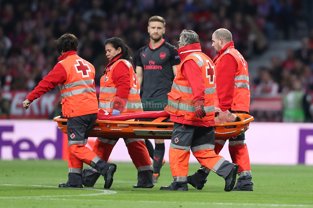 May 3, 2018 - Madrid, Spain - LAURENT KOSCIELNY of Arsenal FC is carried off the pitch on a stretcher after being injured during the UEFA Europa League, semi final, 2nd leg football match between Atletico de Madrid and Arsenal FC on May 3, 2018 at Metropolitano stadium in Madrid, Spain (Credit Image: © Manuel Blondeau via ZUMA Wire)