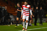 Danny Andrew of Doncaster Rovers (3) disagrees with the assistant referee's decision during the EFL Sky Bet League 1 match between Doncaster Rovers and Sunderland at the Keepmoat Stadium, Doncaster, England on 23 October 2018.