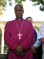 Wednesday 2nd October 2016.<br /> St. George's Cathedral,<br /> Cape Town,<br /> Western Cape,<br /> South Africa.<br /> <br /> #SaveSouthAfrica Silent Prayer Vigil In Cape Town!<br /> <br /> The Most Reverend Dr. Thabo Makgoba (centre with arms folded) and other Religious Leaders stand together in silent protest on the steps of St. George's Cathedral in Cape Town.<br /> <br /> Concerned Religious Leaders and other South Africans gathered together in silent protest in support of the call to #SaveSouthAfrica from 'the acute social crisis that has been brought about by corruption, mismanagement and political intrigue' as reported nationwide in the news. The campaign was formed under the banner of holding government leaders accountable to the Constitution and the values they have pledged to uphold as representatives of the people. The #SaveSouthAfrica Silent Prayer vigil was held at St. George's Cathedral in Cape Town, South Africa on Wednesday 2nd November 2016.<br /> <br /> Picture By:  Mark Wessels / RealTime Images.