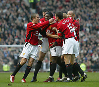 Photo. Andrew Unwin.<br /> Manchester United v Southampton, Barclaycard Premier League, Old Trafford, Manchester 31/01/2004.<br /> Manchester United's Louis Saha (c) is mobbed by his teammates after scoring on his debut.