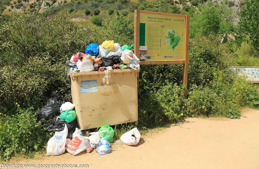 Overflowing rubbish bin at natural park, Cueva del Gato, Benaojan, Serrania de Ronda, Malaga province, Spain
