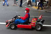 Tourists, dressed as characters from the Mario Carts video game ride go carts through Shibuya streets, Tokyo, Japan Tuesday June 27th 2017. The service run my MariCar books thousands of tours a month mostly for non-Japanese tourists. Though popular with visitors there are  copyright issues with Nintendo, who have asked the company to stop using the characters, and  concerns these small go-carts are a danger to both the driver and other road users in the busy Tokyo traffic