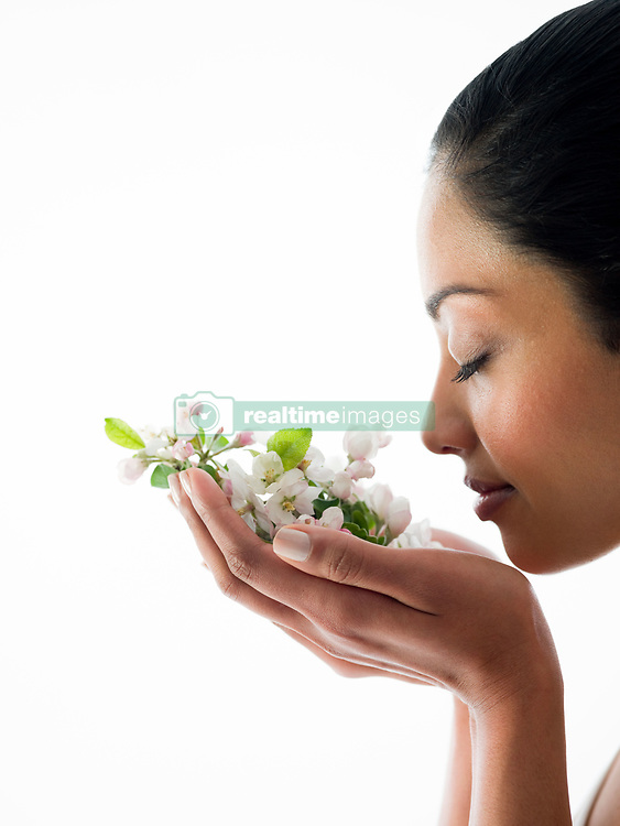 Jul. 26, 2012 - Woman smelling blossom (Credit Image: © Image Source/ZUMAPRESS.com)