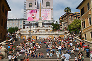 "Tourists and locals mingle at the Spanish Steps in Rome, Italy. The steps, known as ""The Scalinata"" in Italian, are the longest and widest staircase in Europe."