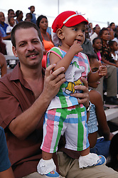 Father and child amongst spectators at Carnival; Havana; Cuba,