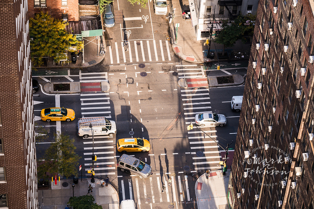 Looking down at traffic and pedestrians at the intersection of E. 54th St & 1st Ave, Mid-town Manhattan, New York, New York, USA