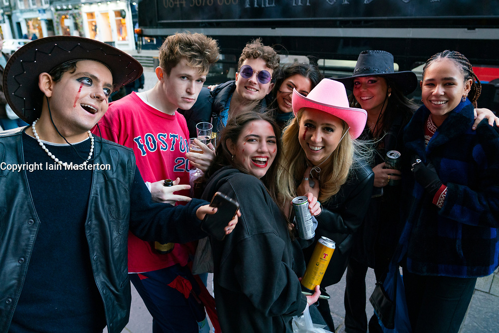 Edinburgh,Scotland, UK. 31 October 2020. Group of young people about to board ghost tour bus to have Halloween party in city centre of Edinburgh. Iain Masterton/Alamy Live News