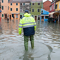 A member of Protezione Civile walks along flooded houses to make sure everybody is safe. More than 59% of Venice was under water on Thursday, as the historic lagoon town was hit by exceptionally high tides. The sea level rose above 140cm overnight and was expected to remain above critical levels for about 15 hours.