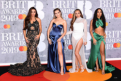 Jesy Nelson, Perrie Edwards, Jade Thirlwall and Leigh-Anne Pinnock of Little Mix attending the Brit Awards 2019 at the O2 Arena, London. Photo credit should read: Doug Peters/EMPICS Entertainment. EDITORIAL USE ONLY