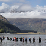 Competitors prepare for the swim leg of competition on Diamond Lake during the Paradise Triathlon and Duathlon series, Paradise, Glenorchy, South Island, New Zealand. 18th February 2012. Photo Tim Clayton