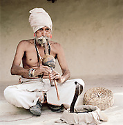 Snake Charmer with a Cobra at Gandhi Nager, Lucknow, Uttar Pradesh, India