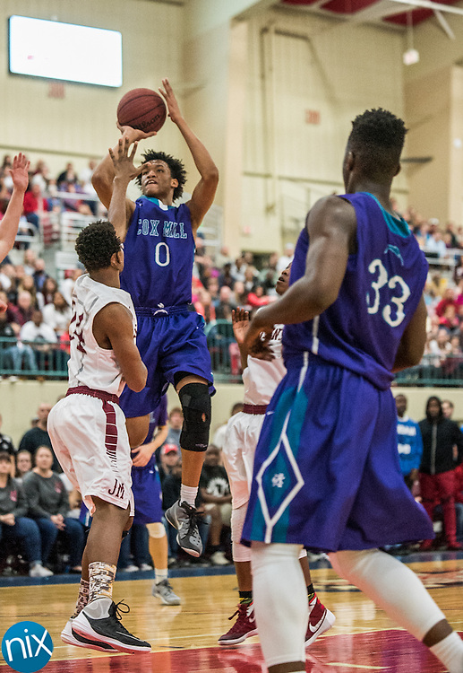 Cox Mill's Wendell Moore (0) takes a shot against Jay M. Robinson during the NCHSAA 3A regional semi-finals at the Cabarrus Arena & Event Center in Concord Tuesday night. Robinson won the game 80-69 to advance to the regional finals.