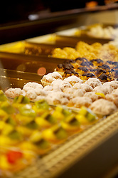 Close up of mini cakes and fruit confection