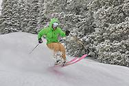Graham Sparks slices through fresh powder on Aspen Mountain while using a pair of his own handmade skis.
