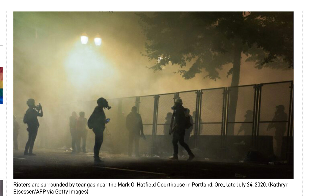 Portland Protestors are surrounded by tear gas near the Mark Ol Hatfield Justice Centerl