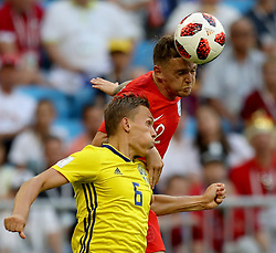 July 7, 2018 - Samara, Russia - KIERAN TRIPPIER (red) of England competes for a header with LUDWIG AUGUSTINSSON of Sweden during the 2018 FIFA World Cup quarter-final match between Sweden and England in Samara. (Credit Image: © Lu Jinbo/Xinhua via ZUMA Wire)