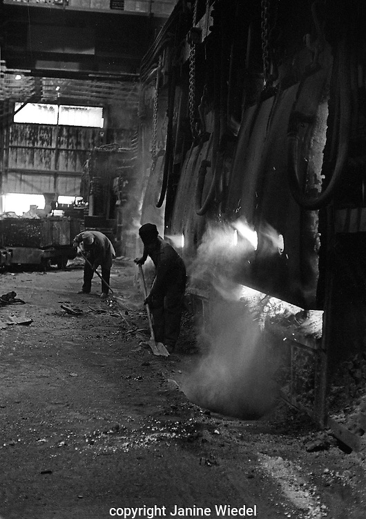 Keeping the open hearth furnace area clean and tidy.The Melting Shop at Bilston Steelworks in the Black Country West Midlands in the 1978