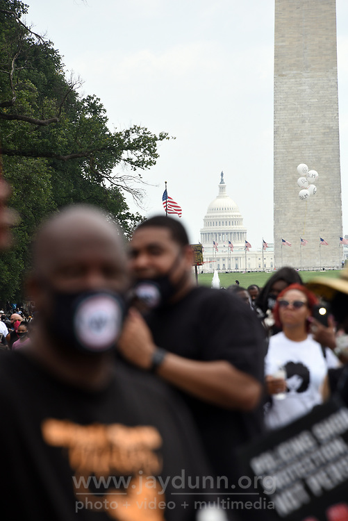 """On Friday, August 28th, 2020, thousands of people from all over the country attended the Commitment March in Washington, D.C.to fight for criminal justice reform in solidarity with those who have lost loved ones at the hands of the police and to push for federal legislation against misconduct. The event, organized by the Reverend Al Sharpton and the National Action Network under the rallying call 'Get Your Knee Off Our Necks,' coincides with and honors the 57thanniversary of Martin Luther King, Jr.'s March on Washington, where he delivered his historic """"I Have A Dream"""" speech in 1963. Photograph by Jay Dunn."""