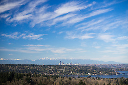 United States, Washington. Lake Washington, Mercer Island, Seattle skyline, and Olympic mountains viewed from Bellevue.