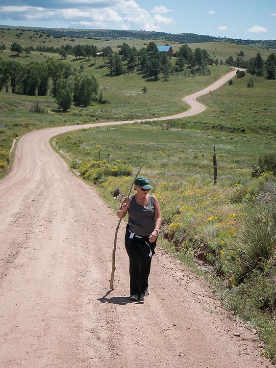 Carol hikes along Wykagyl Road, returning to 106 Shawnee Circle from Antelope Canyon.