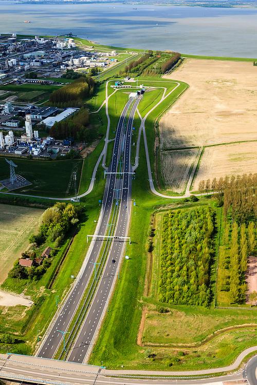Nederland, Zeeland, Terneuzen, 09-05-2013; Zeeuws-Vlaanderen, Terneuzen, zuidelijk ingang van de Westerscheldetunnel. Links de chemische fabrieken van Dow Chemical.<br /> Tunnel entrance of the tunnel in the Westerschelde, connecting Zeeuws-Vlaanderen and Zuid-Beveland (on the horizon) in the province of Zeeland<br /> luchtfoto (toeslag op standard tarieven);<br /> aerial photo (additional fee required);<br /> copyright foto/photo Siebe Swart.