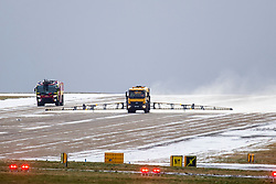 © Licensed to London News Pictures. 08/02/2021. Leeds UK. Snow & ice is cleared from the runway at Leeds Bradford airport in Yorkshire this morning as the UK is battered by Storm Darcy. Photo credit: Andrew McCaren/LNP