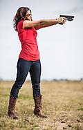Woman with a handgun.
