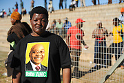 Workers' Day is a national public holiday in South Africa and since 1994, it is being celebrated on 1 May each year. It has its origins within the historical struggles of workers and their trade unions internationally for solidarity between working people in their struggles to win fair employment standards and more importantly, to establish a culture of human and worker rights and to ensure that these are enshrined in international law and the national law of those countries aligned to the International Labour Organisation. On the photo a young man who's supporting the ANC party  lead by president Jacob Zuma (2010)