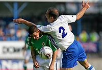 Photo: Andrew Unwin.<br />Northern Ireland v Azerbaijan. FIFA World Cup Qualifying match. 03/09/2005.<br />Azerbaijan's Rafael Amirbekov (R) climbs all over Northern Ireland's David Healy (L).