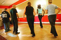 Men and Women in a Salsa dancing class,