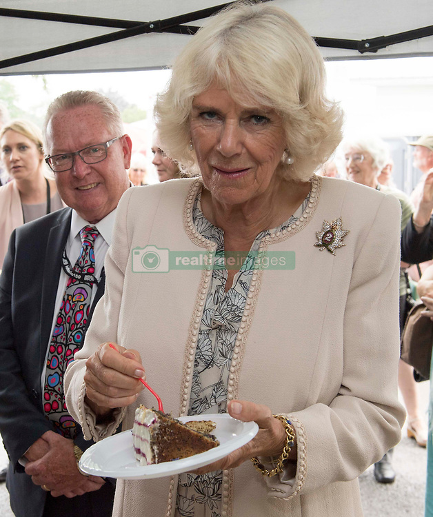The Duchess of Cornwall eating cake during her visit to Wellington Farmer's Market, Lake Ontario during day two of her visit to Canada.