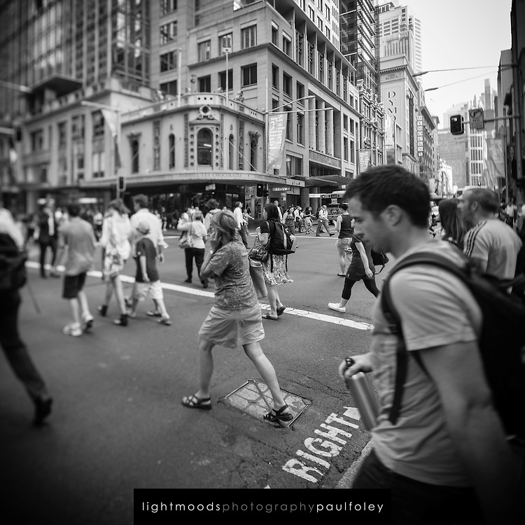 People crossing on street corners in Sydney, Australia