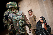 During a joint U.S.-Afghan mission to Nur Mohammad Kalache, an Afghan woman explains to Afghan soldiers that there are no Taliban fighters in her village. She complained that the soldiers ruined the annual grape crop by trampling it on the rooftops and asks for money for compensation.