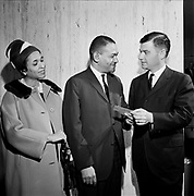 """Y-640421.  NAACP convention at Hilton. Governor Mark Hatfield, Mr. & Mrs. Webb.  Ticket for """"NAACP Freedon TV Spectacular. Closed circuit direct from New York and Hollywood. Thursday, May 14, 1964 Municipal Auditorium."""" Caption on one published versison pg. 114 The History Of Portland's African American Community. """"Attorney Mayfield K. Webb and his wife, Juretta Webb, present the former Governor Mark Hatfield with two tickets to the NAACP Freedom TV Spectacular"""" photo taken April 21, 1964."""
