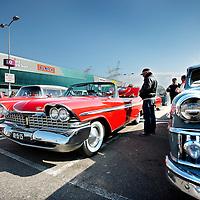 Nederland, Amsterdam , 31 maart 2013.<br /> Allerlaatste King Cruiseop het Maxis terrein op de Pampusweg bij Muiden.<br /> <br /> Wendy Pothuizen showt haar oude Amerikaan aan het publiek.<br /> Meeting of oldtimers and their owners.