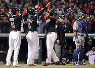 CLEVELAND, OH - OCTOBER 25: Roberto Perez #55 of the Cleveland Indians is greeted at home plate after hitting a two-run home run in the eighth inning during Game 1 of the 2016 World Series against the Chicago Cubs at Progressive Field on Tuesday, October 25, 2016 in Cleveland, Ohio. (Photo by Ron Vesely/MLB Photos via Getty Images)