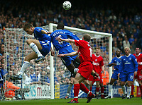 Photograph: Scott Heavey<br />Chelsea V Liverpool. 11/05/2003.<br />Jesper Gronkjaer and Marcel Desailly fly in for the same ball during this FA Barclaycard Premiership clash for the right to play in the Champions League next season.