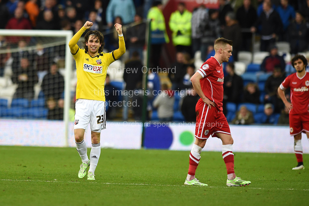 Jota Peleteiro Ramallo of Brentford (l) celebrates after he scores his teams 3rd goal. Skybet football league championship match, Cardiff city v Brentford at the Cardiff city stadium in Cardiff, South Wales on Saturday 20th December 2014<br /> pic by Andrew Orchard, Andrew Orchard sports photography.