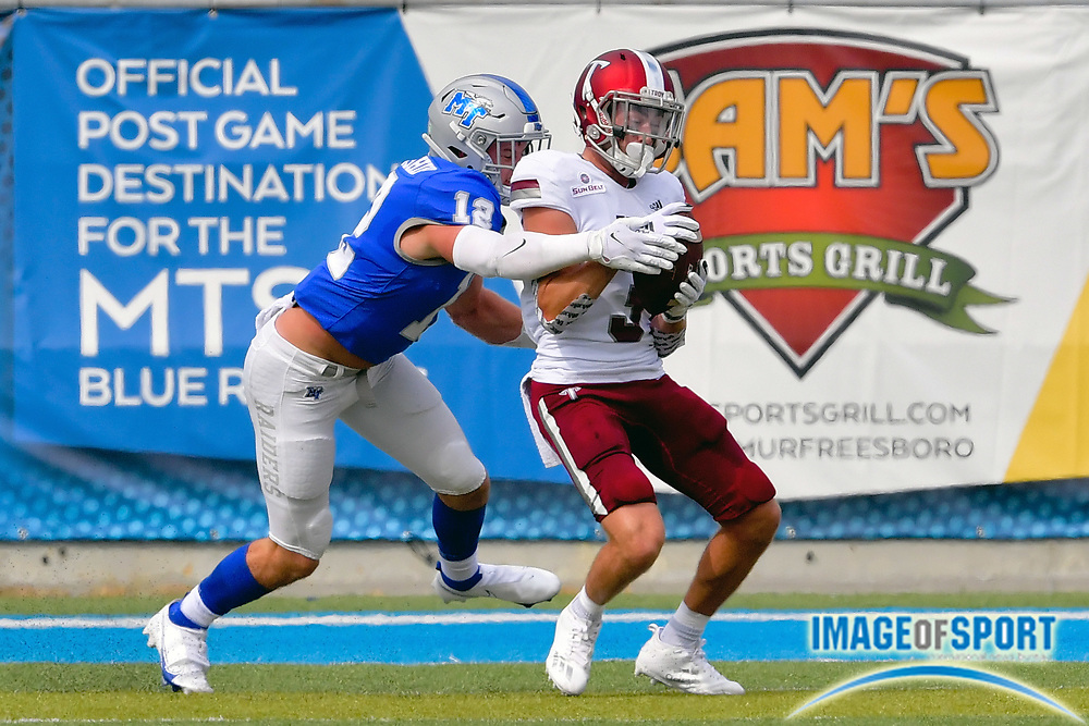 """Troy Trojans wide receiver Bret Clark (3) is stopped by Middle Tennessee Blue Raiders safety Reed Blankenship (12) during the first half at Johnny """"Red"""" Floyd Stadium in Murfreesboro, Tenn., Saturday, Sept. 19, 2020. (Jim Brown/Image of Sport)"""