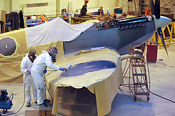 "© Licensed to London News Pictures. File picture dated 13/12/2012. Bristol, UK. Steve Atkin and Alec Kinane of Warbird Colour repainting a Mark IX Spitfire. Engineers race to finish work rebuilding a Mark IX Spitfire fighter circa 1943, at Filton airfield near Bristol. The plane has been rebuilt  by John Hart engineering, it is the last plane to be completed at the airfield and was flown out on 18 December 2012 by pilot Bill Perrins. Filton, the birthplace of the British-built Concorde jets, is to close on Friday (21st December 2012). Its owner BAE Systems says it is not viable and intends to sell it for housing and business development. BAE Systems said the airfield was closing following a comprehensive assessment over a five-year period and an independent review, ""both of which concluded that the airfield was not economically viable"".  Airbus has said it is fully committed to the Filton site, where it has a base making aircraft wings.  A spokesman said: ""The closure of the airfield will have no significant effect on our business and we have mitigation plans in place regarding the change of venue for our passenger shuttle (using Bristol airport) and the transportation of the A400M wings (via Portbury docks).  Planes currently based at Filton will have to find new homes. The airfield officially closes for flights this Friday, though the police helicopter will still be based there. BAE is supporting a new museum at Filton to ""house Concorde Alpha-Foxtrot and Bristol's aviation heritage."".Photo credit : Simon Chapman/LNP"