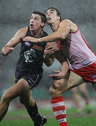 Matthew Kreuzer of the Blues and Mike Pyke of the Swans contest the ball during the 2013 AFL Round 14 match between the Sydney Swans and the Carlton Blues at the SCG, Sydney on June 28, 2013. (Photo: Craig Golding/AFL Media)
