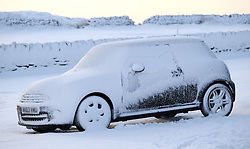 © Licensed to London News Pictures. <br /> 27/12/2014. <br /> <br /> Castleton, United Kingdom.<br /> <br /> A car left overnight at The Lion Inn near Castleton is covered in snow on the North Yorkshire Moors after overnight snowfall caused disruption in some parts of the country.<br /> <br /> Photo credit : Ian Forsyth/LNP